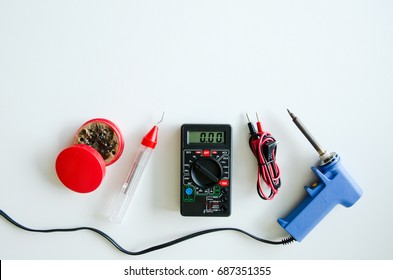 Tools to use in electrical installations on white background. Digital multimeter on white background.