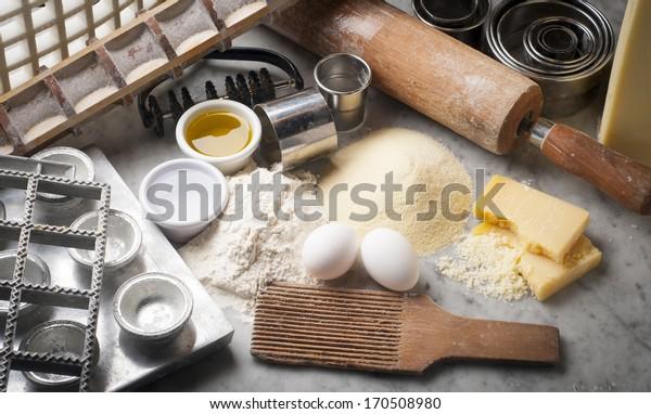 Tools, utensils, ingredients to make fresh pasta
