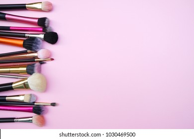 Tools of women beauty fashion cosmetic brush products for facial.Top view,flat lay on the pastel pink background.Copyspace for text