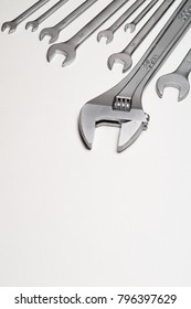 Tools wrenches with the edge of the frame. Background for design on a mechanical theme.