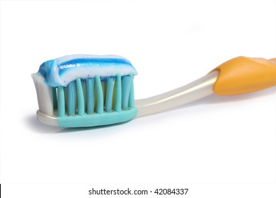 tooth brush with paste on  white background