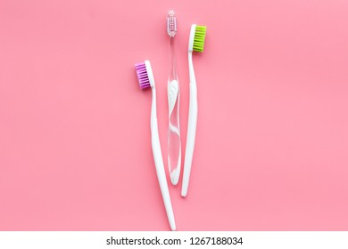 Tooth care with toothbrush. Set of cleaning products for teeth on pink background top view copy space