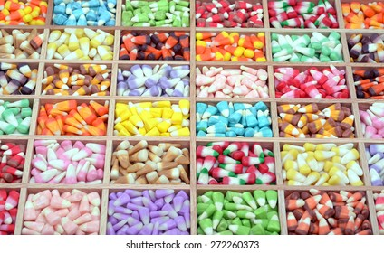 a lot of tooth corn candies in wooden case for background