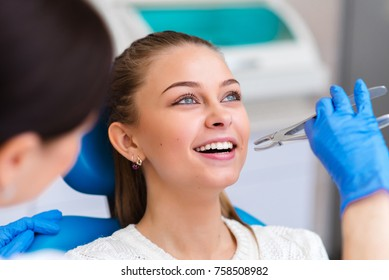 Tooth extraction beautiful girl in dentistry.