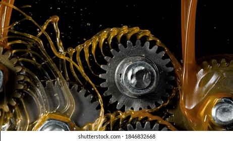 Tooth gear wheel with oil splashes, freeze motion, lubrication concept - Shutterstock ID 1846832668