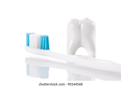 tooth and toothbrush isolated on white background