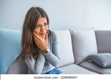 Toothache, Beautiful Woman with Tooth Infection. Young Woman Suffering From Toothache . Close up of pretty disappointed woman which having toothache