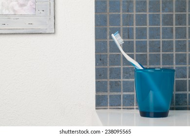 Toothbrush in a blue glass