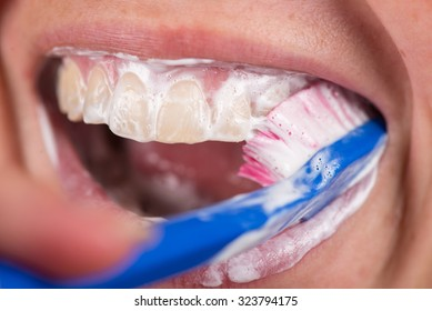 The toothbrush cleans teeth