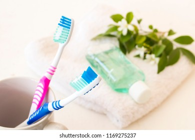 toothbrush mouthwash and terry cloth for health care oral cavity on background white