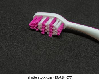 toothbrush on a black background