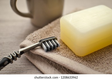 Toothbrush on the towel. Natural soap. Clean and healthy. Hygiene items on the table. Calm colors.