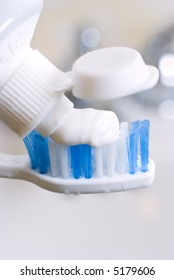 toothbrush and toothpaste close-up