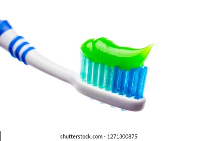 toothbrush and toothpaste on an isolated background