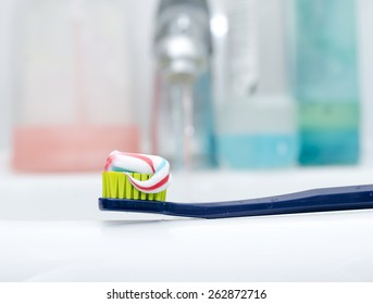Toothbrush With Toothpaste at the sink as the concept of dental hygiene