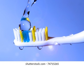 toothbrush under the running water