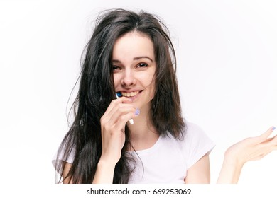 Toothbrush, young woman on white isolated background brushes teeth, brunette.