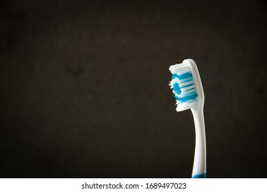 toothbrushe of blue, colors on a black background, close-up
