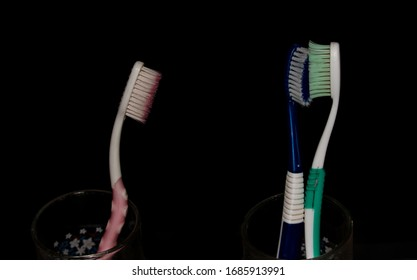 Toothbrushes in a glass abstract