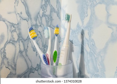 Toothbrushes in a glass. Family dental care.