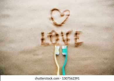 Toothbrushes in love on background.Love and Valentines day concept.Creative flat lay photo.Top view.Copy sace.