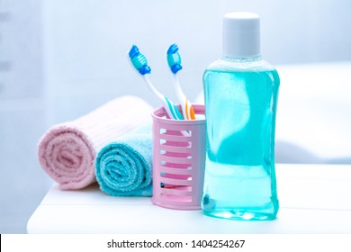 Toothbrushes and mouthwash in the bathroom for oral hygiene, health of teeth and gums. Teeth care.