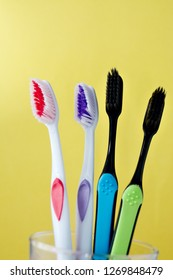 toothbrushes are multicolored on a bright colored background close-up