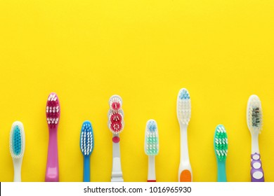 Toothbrushes on yellow background