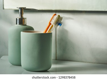 Toothbrushes in the toilet room