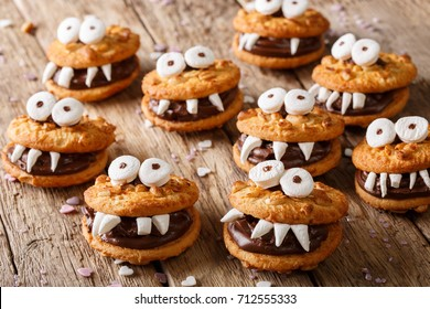 Toothed monsters of cookies close-up on a table for Halloween. horizontal