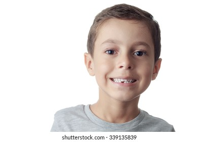 toothless smiling boy showing his lost tooth milk
