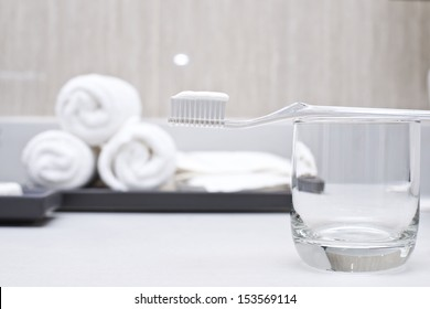 toothpaste on toothbrush in bathrom