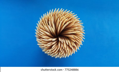 Toothpick and blue background