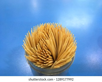 Toothpick in box Isolated on blue background