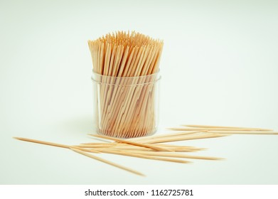A toothpick in a dozen on a white background.