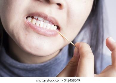Toothpick her Teeth