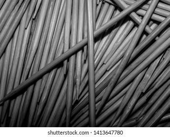 A lot of toothpicks lying on the table. Black and white photography. Toothpick. Toothpicks are lying on the table. A lot of toothpicks. Kitchen.