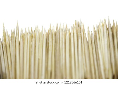 Toothpicks on a white background. Bamboo Toothpicks