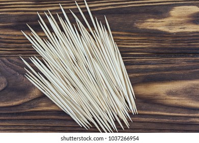 toothpicks on a wooden background