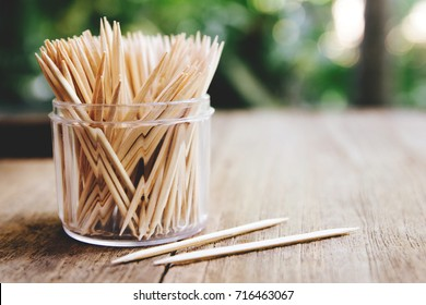 Toothpicks on wooden table for background , (close up)