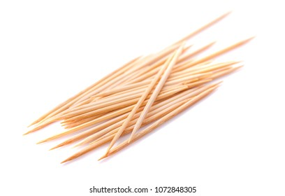 Toothpicks scattered. Close up. Isolated on white background.