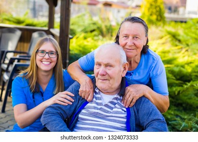 Toothy smile from physician caring of senior couple at the nursing home.