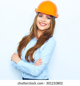 Toothy smiling business woman wearing a building helmet studio portrait isolated. Young woman.
