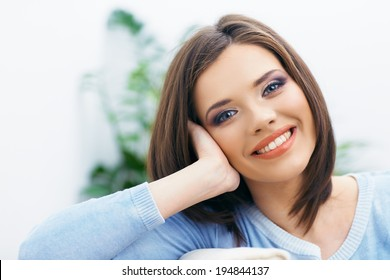 Toothy smiling girl close up portrait. Long hair young model.