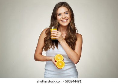 toothy smiling girl portrait with orange juice and fruit. isolated studio background.