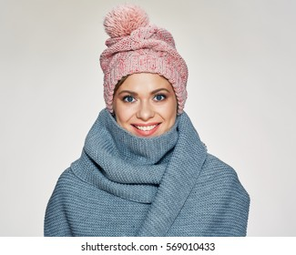 Toothy smiling woman portrait wearing winter scarf and hat. studio isolated .