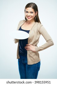 Toothy smiling young woman show empty white plate. Studio isolated concept portrait.