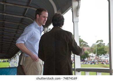 TOOWOOMBA, AUSTRALIA - MARCH 20: Prince William visits the 'Spirit of the Country' flood relief country music concert on March 20, 2011 in Toowoomba, Australia. He stands with country music star Troy Cassar-Daley.