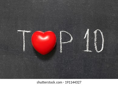 top 10 phrase handwritten on chalkboard with heart symbol instead of O
