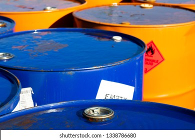 Top of 200 litre 55 US gallon empty gasoline drums in storage area awaiting pick up